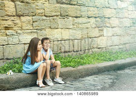 Small friendly kids on street