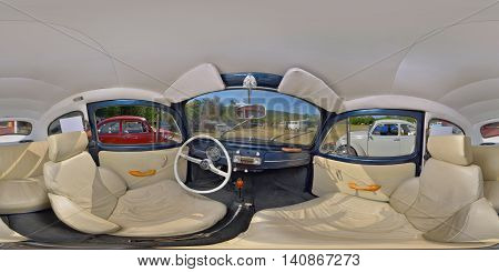 SUB CETATE, ROMANIA - July 16: 360 panorama of the interior of a classic Volkswagen Type 1 Beetle painted blue with white leather seats on July 16th, 2016, in Zeteváralja (Sub Cetate), Transylvania, Romania.