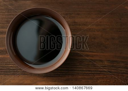 Fresh soy sauce on wooden background