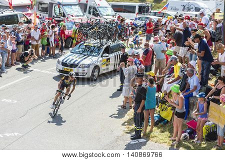 Col du Glandon France - July 23 2015: The South African cyclist Jacques Janse van Rensburg of MTN Qhubeka Team riding in a beautiful curve at Col du Glandon in Alps during the stage 18 of Le Tour de France 2015.