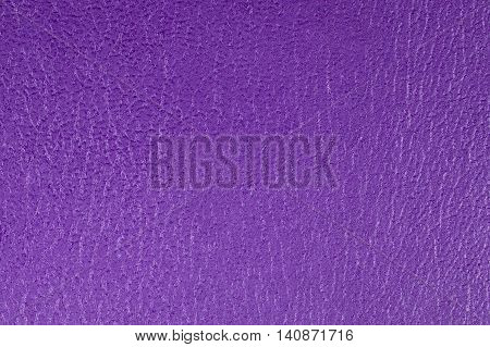 Purple embossed decorative leatherette texture background, close up