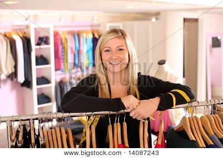 Portrait of clothing store owner