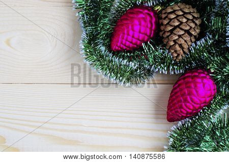 Snowflakes and pine cones on wooden background. Christmas and New Year Decoration, flat lay
