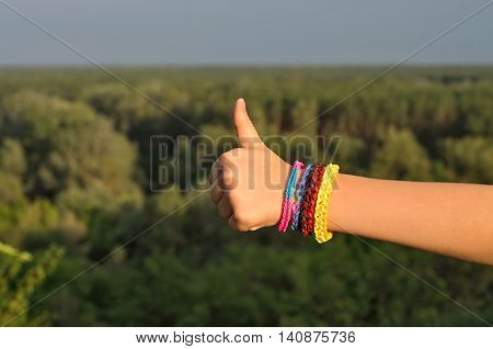сhild's hand with a bracelet thumbs up