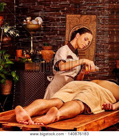 Man having oil Ayurveda massage spa in Indian spa massage salon.