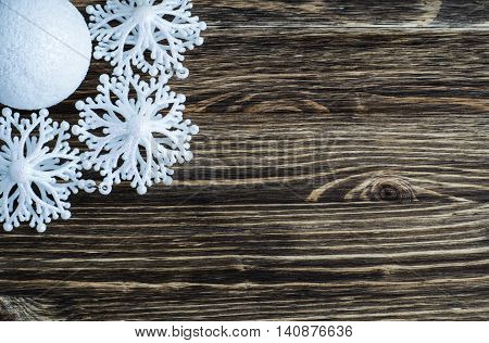 Snowflakes on a wooden background. Christmas and New Year Decoration, flat lay