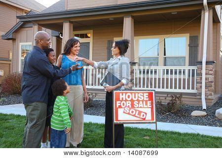 Realtor gives family keys to new home