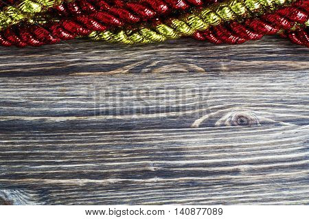 Christmas and New Year Decoration on wooden background. Winter holidays concept. Tinsel border.
