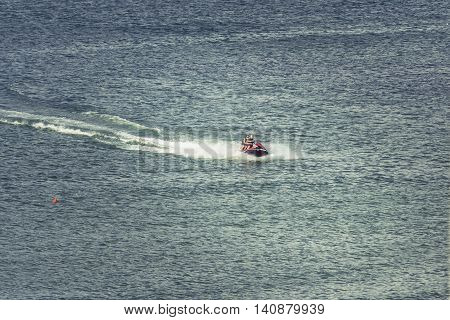Mamaia Romania - July 18 2016: Tourists riding a jetski. Man on ski jet. Professional jet ski rider