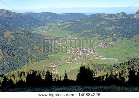 View in the Tannheim Valley in East Allgaeu and the foothills of the Alps in Tyrol, Austria; blue sky