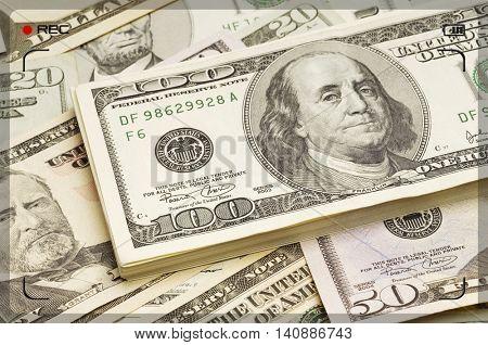 recording the 100 dollar bills