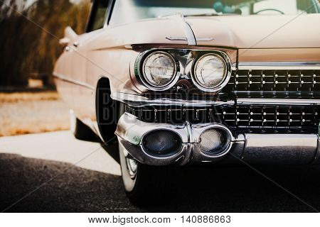 Detail of front light of an american vintage car.