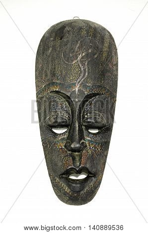 Vintage tiki mask isolated on white background.
