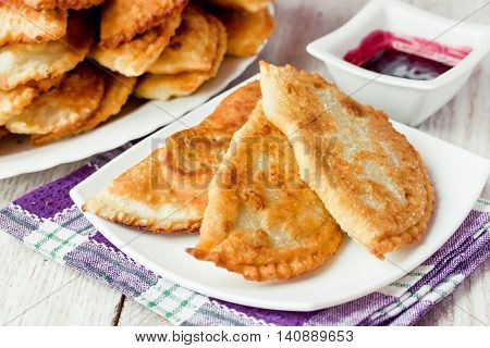 Cheburek pie with meat and pomegranate sauce - traditional caucasian cuisine selective focus