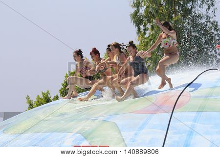 Rhodes Greece-July 30 2016: Group of girls and women on the vet bubble.Vet bubble is very popular for young people in the Water Park.Water Park is located on the island of Rhodes in Greece and one of the most largest in Europe and is a very popular place
