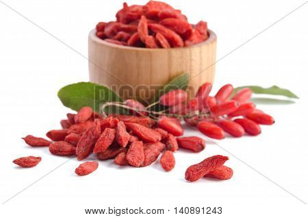 berberries near goji berries heap and bowl with goji isolated on white background