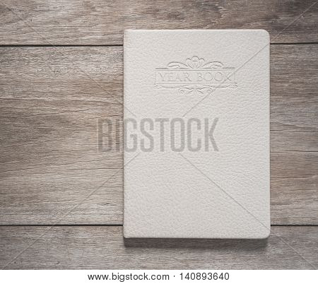 Top View Of White Book On Old Wooden Plank