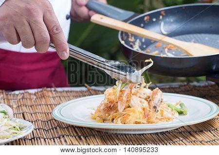 Chef decorated Pad Thai Menu / cooking Pad Thai concept