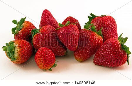 Organic Strawberries - A beautiful cluster of sweet ripe berries (A great image for nutrition, food, culinary, industries!)
