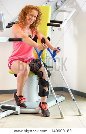 Patient Using Crutches And Orthopedic Brace