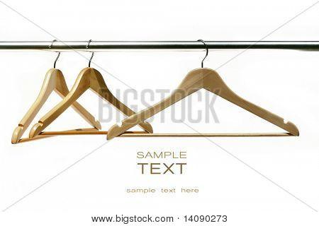 Three coat hangers on a clothes rail