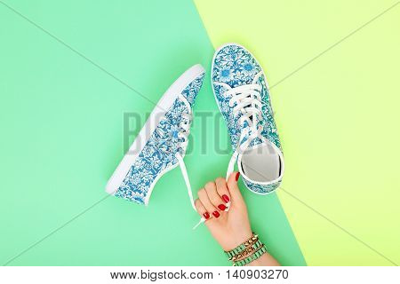 Fashion. Clothes Accessories fashion Set. Female hand and Stylish Trendy gumshoes, Glamor bracelet. Summer fashion girl Outfit, accessories. Hipster Essentials. Minimal fashion style
