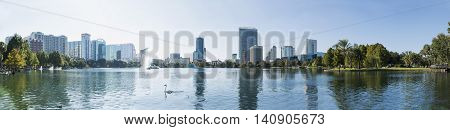 Orlando downtown Lake Eola big panorama with urban buildings and reflection. Florida