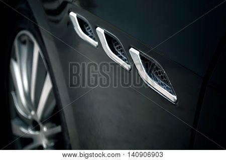 Close-up of sport car details. Concept of automotive wallpaper