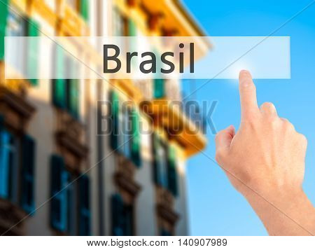 Brasil - Hand Pressing A Button On Blurred Background Concept On Visual Screen.