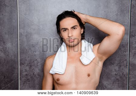 Portrait  Of Sexy Young Man With  White Towel Touching His Black Hair