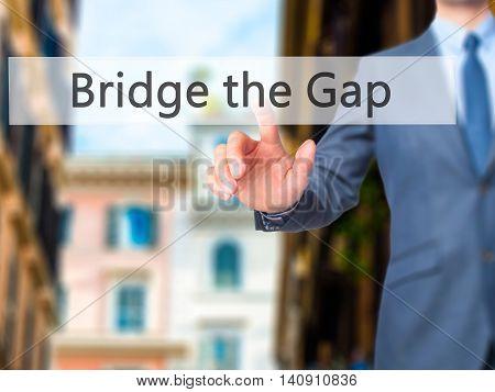 Bridge The Gap - Businessman Hand Touch  Button On Virtual  Screen Interface