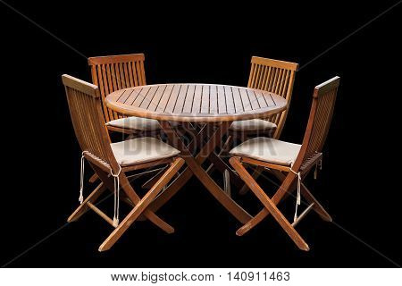 Set Of Teak Wood Table And Chairs Isolated On Black. Saved With Clipping Path