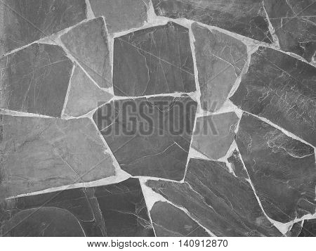 Gray stone wall in resort. Nature background.