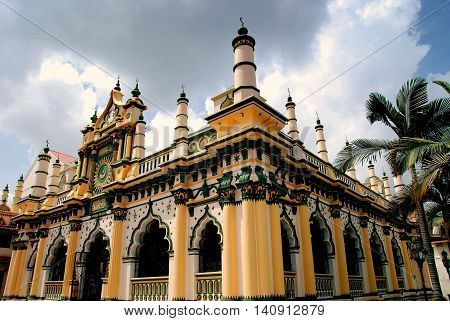 Singapore - December 18 2007 1907 Masjid Abdul Gaffoor Mosque in Little India with its 22 small minarets Moorish windows and decorative entrance pediment