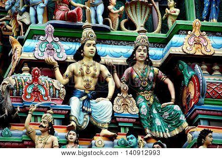 Singapore - December 17 2007: Hand-painted carved figures cover the Gopuram Sikhara entrance gate at the Sri Srinivasa Perumal Hindu Temple on Serangoon Road in Little India