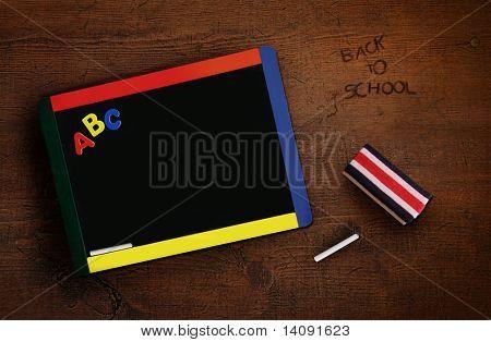 Child's chalkboard with eraser on old antique desk