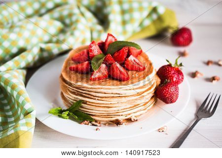 Delicious Pancakes With Strawberry On Wooden Background