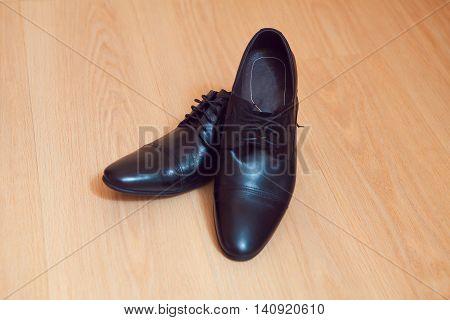 Men's Loafer Shoe on old wood background.