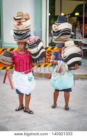 Leon Nicaragua - December 14 2015: portrait of woman from Nicaragua selling hats on the street