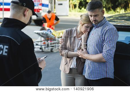Anxious parents of an accident casualty talking with the police poster