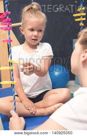 Little girl on individual physiotherapy classes of sensory integration.