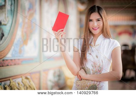 Chinese Woman Dress Traditional Cheongsam And Hold Red Envelope