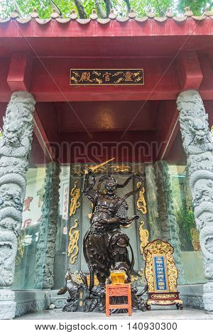 Statue of a warrior god in Wong Tai Sin Temple, Hong Kong.