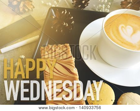 Happy Wednesday word on coffee with dessert background