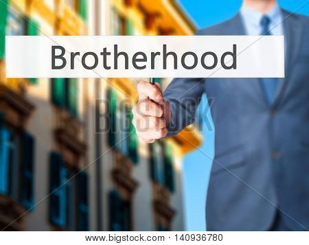 Brotherhood - Businessman Hand Holding Sign