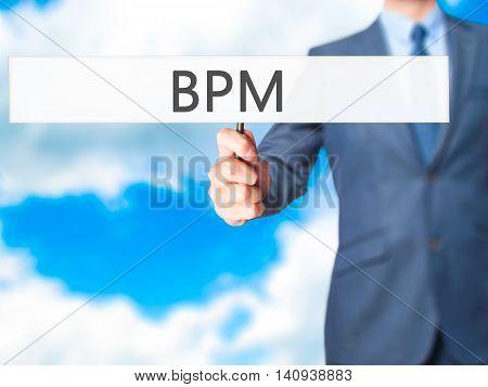 Bpm (business Process Management) - Businessman Hand Holding Sign