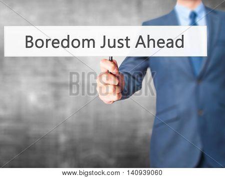 Boredom Just Ahead - Businessman Hand Holding Sign
