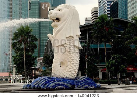 Singapore - December 12 2007: The 70 ton 26 foot high Merlion Fountain a lion's head on a fish's body the city's symbol since its unveiling in 1972 in Merlion Park