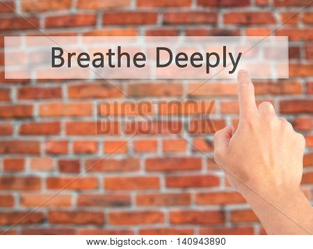 Breathe Deeply - Hand Pressing A Button On Blurred Background Concept On Visual Screen.