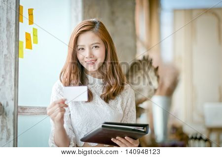 Beautiful Businesswoman With Smile,showing Blank Name Card